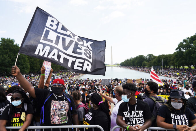 People attend the March on Washington, Aug. 28, in Washington, on the 57th anniversary of the Rev. Martin Luther King Jr.'s